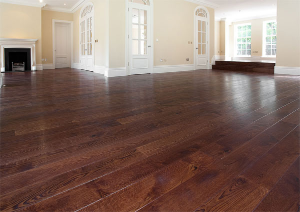 Engineered dark wooden floor large room