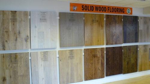 Inside UK Wood Floor's showroom with flooring samples on the wall