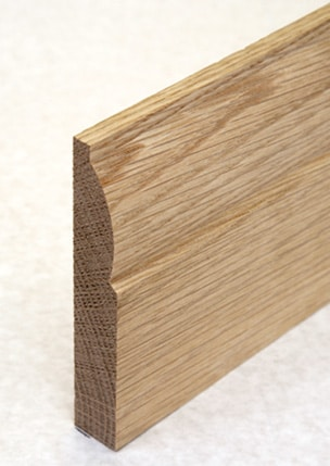 Wooden skirting with lamb's tongue finish