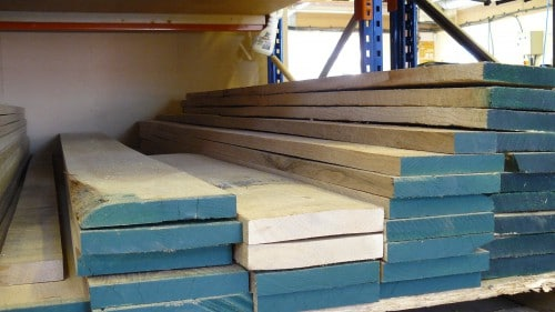 A stack of wooden oak planks ready for manufacturing