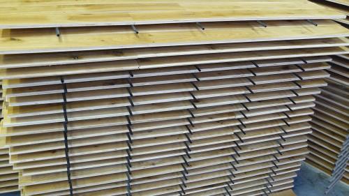 Wooden flooring on drying racks